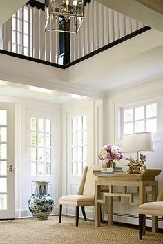 I love this foyer that is open to the second floor of the home. Light pours in from all the windows on both levels. A gorgeous space...V