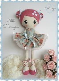 Boutique Honey Doll Mayastands at 30cm tall she wears her hair in tiny little side buns with cute satin bows on either side