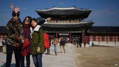 """In South Korea, selling a """"selfie stick"""" that lets people photograph themselves could mean a fine of up to £17,300 if the gadget is unregistered."""
