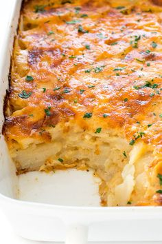 The BEST Scalloped Potatoes Recipe! - Chef Savvy - - The BEST Scalloped Potatoes made with thinly sliced russet potatoes layered in a creamy cheese sauce then baked until golden brown. The perfect side dish! Potato Sides, Potato Side Dishes, Vegetable Side Dishes, Vegetable Recipes, Russet Potato Recipes, Mashed Potato Recipes, Best Potato Bake Recipe, Best Potato Recipes, Sauce Crémeuse