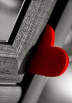 Red heart stuck in a door
