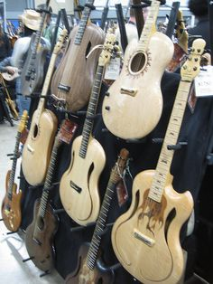 Guitars - intriguing rounded bodies with no indent or very little for a horn. #cSw:) - Boz Brothers.