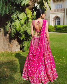 Alert Bride-to-be's! These sexy blouse back ideas will make you want to grab your sarees and lehenga's now! Take your pick to create a photo opportunity that you'll cherish! Pink Bridal Lehenga, Designer Bridal Lehenga, Indian Bridal Lehenga, Pink Lehenga, Pakistani Bridal, Half Saree Designs, Lehenga Designs, Saree Blouse Designs, Choli Designs