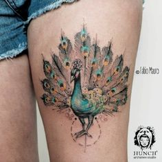 Bird Tattoo by Fabio Mauro - Peacock tattoo by Fabio Mauro. A majestic peacock is drawn flaunting its feathers in blue and orange color theme.