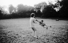 Mick Jagger playing with Marianne Faithfull's son Nicholas