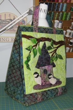 Bag made using a McKenna Ryan block. It's not really a quilt, but I think the applique is art.