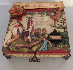 Altered box. Graphic 45 Christmas Emporium and Twelve Days of Christmas papers.  Tim Holtz Idea-ology findings.