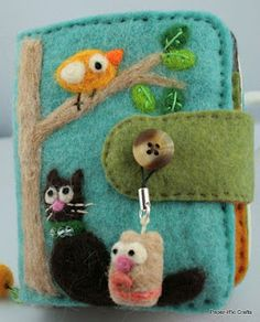 Needle felted wallet.  I need to make another one as I gave this one away.