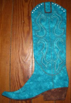 Cowboy boot Christmas stocking pattern from: http://www.craftsy.com/pattern/sewing/home-decor/2013-cowboy-boot-christmas-stocking/75804