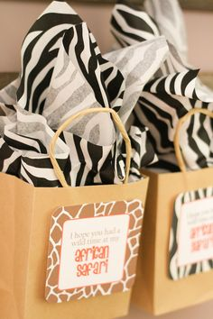 Dollar store has animal print napkins that could be used as stuffer and could use plain paper bags decorated.