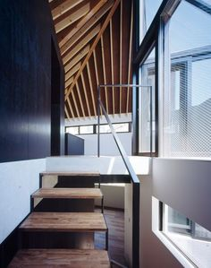 A pointy wooden roof tops this concrete house in Tokyo, which led Apollo Architects & Associates to name the building Hat.