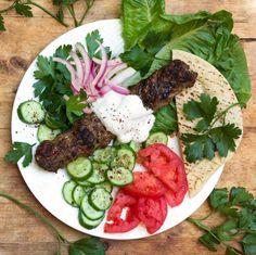 Turkish lamb kafta kebabs with fresh vegetables, pita and garlicky yogurt sauce