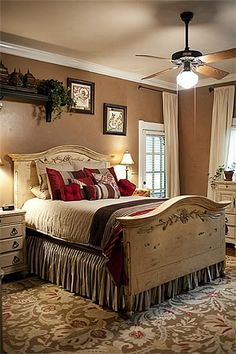 Love the colors, the red with tans and black. Also love the antiqued white furniture.