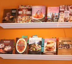 the cookbook wall bookstore style cookbook storage second rule : kitchen cookbook shelf Cookbook Display, Cookbook Storage, Cookbook Shelf, Cookbook Holder, New Kitchen, Kitchen Dining, Kitchen Decor, Kitchen Ideas, Natural Kitchen