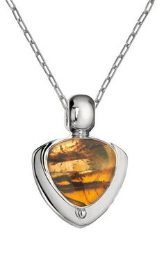 Encapsulated in polished silver, the golden honey amber stone is a winner for its all-season, all-ages versatility. Channel it with your favorite vintage dress and mary janes for a retro appeal. Chiapas Amber   Amber Jewelry   sterling silver pendant   amber pendant necklace   Yellow amber pendant   handmade amber necklace