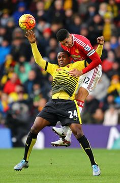 Odion Ighalo of Watford battles with Chris Smalling of Manchester United during the Barclays Premier League match between Watford and Manchester...