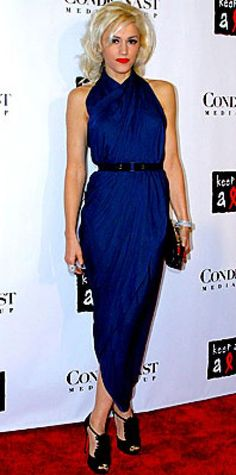 Look of the Day › October 29, 2007 Stefani made the most of her animal magnetism by accessorizing her navy Lanvin dress with a Cartier snake bracelet and panther ring. The Louboutin-shod star performed at the Black Ball concert for Keep a Child Alive in New York.