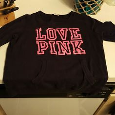 Victorias Secret Pink Pullover Victorias Secret Pink pullover. Black with love pink in neon pink. Pocket on the front. No hood. Excellent used condition. PINK Victoria's Secret Tops