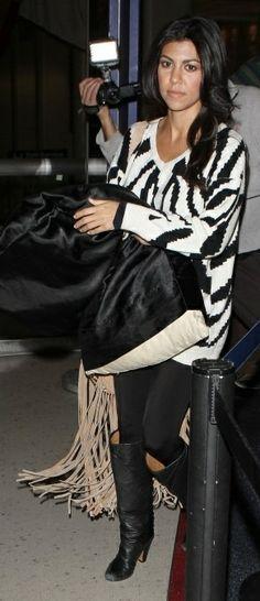 Who made Kourtney Kardashian's black leggings, boots, sweater and fringe bag that she wore in New York? Sweater – Myne  Pants – LnA  Shoes – Margiella  Bag – Stella and Jamie