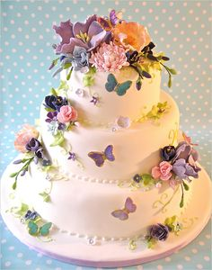 Wedding Cake with purple butterflies and assorted flowers~Perfect for a light-hearted, whimsical garden wedding!