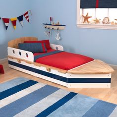 @Overstock - KidKraft Boat Toddler Bed - Nestle him into nautical-themed dreams when you tuck him into this boat-style bed. Cute maritime detailing and a sturdy build complete this children's bedroom furniture--ready to match your beach or sea decor. http://www.overstock.com/Sports-Toys/KidKraft-Boat-Toddler-Bed/9294767/product.html?CID=214117 $194.99