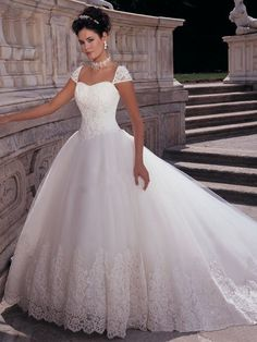 I wonder if something could be done with the sleeves and neckline?   18 Glamorous Wedding Dresses