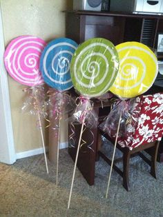 Candy land suckers: made from foam board, dowel rods, and cellophane wrap!!! all came from Dollar Tree!!!
