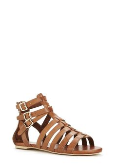 Go for a gladiator in Kisamine, a strappy sandal that features an open toe, adjustable ankle straps, and a functional back zipper. Faux leather upper....