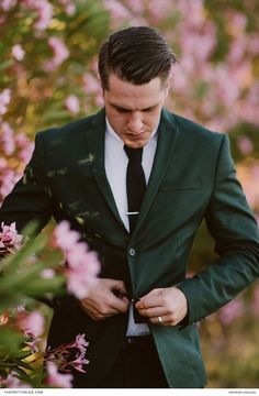 Pink and green wedding inspiration with a slight hippie twist! Dark green suit with black tie!