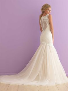 Allure Romance 2911 Whispers of lace and ethereal tulle forge an undeniably…