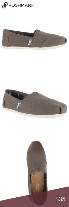 TOMS Classic Canvas Ash Grey  Women's Shoes a customer return, displayed at store, in excellent condition, like new... original and authentic.  Comfortable and casual these Classic Canvas shoes by Toms are made from quality canvas materials ensuring years of use without premature wear. These shoes feature a square toe and manmade sole.  Product Features: Brand: TOMS Color: ASh Targeted Group: Women Style: Slip On Occasion: Casual Shoe Toms Shoes Flats & Loafers