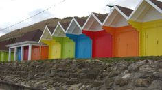 Scarborough    A row of colorful beach huts in the UK awaits Summer sunbathers.