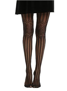 """Add a touch of elegance to your look with these black tights that feature vertical stripes and contrasting horizontal floral lace knee details. They pair wonderfully with that go-to little black skirt you love so dearly.<br><ul><li style=""""list-style-position: inside !important; list-style-type: disc !important"""">One size fits most</li><li style=""""list-style-position: inside !important; list-style-type: disc !important"""">85% nylon; 15% spandex</li><li style=""""list-style-position: inside…"""