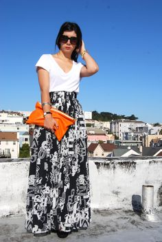 I'm all about this gorgeousness: black and white maxi skirt and that pop of color via a clutch
