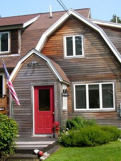 I really want to paint my front door red, but the exterior of our house is limestone and natural cedar siding, and I'm not sure how it would look. This is at least one example of something similar. Barn Siding, Cedar Siding, House Siding, House Roof, Modern Farmhouse Exterior, Farmhouse Design, Cedar Cladding, Gambrel Roof, Cedar Homes