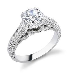 Women's handmade engagement ring in platinum with round center diamond and channel bead set band by Liberty Diamonds.