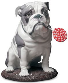 The Bulldog with Lollipop Sculpture/Figurine by Lladro is part of the Lladro Dog & Candy Collection. The sculpture beautifully portrays both the noble air of an imperious bulldog and the inquisitive, playfully naughty side of a loved pet. Porcelain Doll Costume, Fauna, Large Dogs, Animals And Pets, French Bulldog, Dog Lovers, Dolls, Collectible Figurines, Toy Dogs