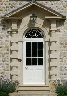 Georgian glazed and panelled entrance door. 9 pane upper with raised & fielded panels to lower part. Arched fanlight with decorative lambs tongue glazing bars Georgian Buildings, Georgian Architecture, Architecture Details, Grand Entrance, Entrance Doors, Door Design, House Design, Georgian Doors, Cottage Front Doors