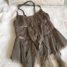 Armani Exchange top Armani Exchange Top. Zipper side, crisscross back with stretch, flowy sheer over material, front hangs down. Never been worn but by zipper has small snag shown in picture. Can't see unless pulling. Armani Exchange Tops Tank Tops