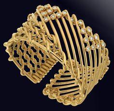 Diamond Gold Triangular Motif Netting Bracelet | From a unique collection of vintage modern bracelets at https://www.1stdibs.com/jewelry/bracelets/modern-bracelets/