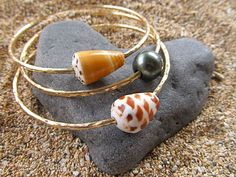 3 Gold Bangles Tahitian Pearl Hawaiian Shells~    This listing is for 1 beautiful gold bangle with a Tahitian pearl and 2 with Hawaiian Shells