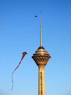 Kites flying around Milad tower, Tehran, Iran