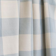 A classic, spa-aqua blue buffalo check with natural cream.Perfect for drapery, roman blinds, curtains, pillows, seat cushions, slipcovers and other upholstery a