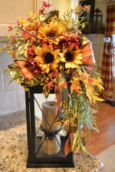 Dress up your lantern with a pretty fall swag. It is full of beautiful fall flowers, berries and ribbon. This swag attaches to your own lantern Fall Lanterns, Lanterns Decor, Fall Lantern Centerpieces, Fall Swags, Fall Wreaths, Advent Wreaths, Fall Flower Arrangements, Autumn Decorating, Decoration Table