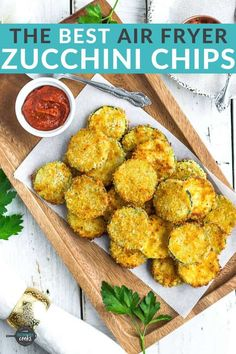 Make amazing Air Fryer Zucchini Chips for your family with this simple recipe! A crunchy coating of panko breadcrumbs and parmesan cheese make these healthier fried zucchini chips poppable and irresistible. No air fryer? You'll also find alternative cooking methods in the post. Air Fyer Recipes, Air Fryer Dinner Recipes, Air Fryer Recipes Easy, Appetizer Recipes, Cooking Recipes, Appetizers, Fried Zucchini Chips, Fried Zucchini Recipes, Zucchini Side Dishes