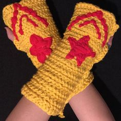 Embrace your inner Amazon with these hand crocheted Wonder Woman fingerless gloves. Crocheted with a mix of goldenrods like the gold of her bracelets and detailed in red. Designed in a mix of classic Wonder Woman, New 52, and movie these fingerless gloves will speak to the Wonder Woman in all of us. The Wonder Woman fingerless gloves are great to add to an easy cosplay or just wear in real life to show your love of comics. My fingerless gloves are unisex. They are 10 inches long and about 10…