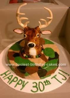 Homemade Deer Hunter Cake: This Deer Hunter Cake was made for an avid deer hunter. It is a double layer 8-inch cake covered in camo fondant. The fondant deer head is sculpted by