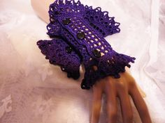 Purple crochet wrist cuffs...I so love these and I love the color! (Scarletrabbit on Etsy)