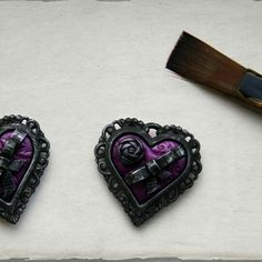 The finishing touches being added to these minuature chocolate box heart pendants made from polymer clay and brass.