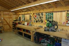 Interior of One & A Half Story Post and Beam Country Barn with Options is part of Garage workshop - Woodworking Ideas Table, Woodworking Shop Layout, Woodworking Workbench, Woodworking Workshop, Woodworking Furniture, Custom Woodworking, Woodworking Projects, Woodworking Classes, Garage Workbench